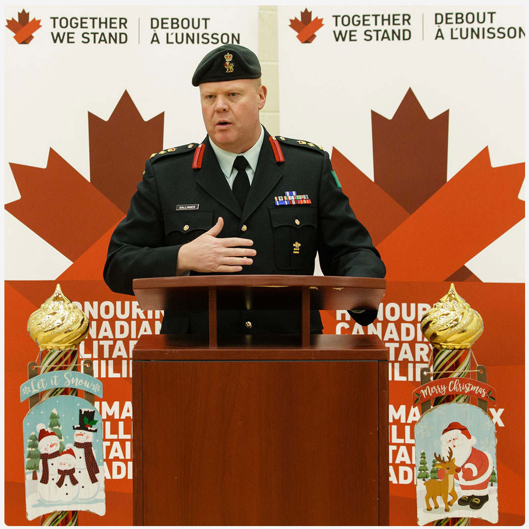 An image of a member of the Canadian Armed Forces speaking at a Together We Stand event