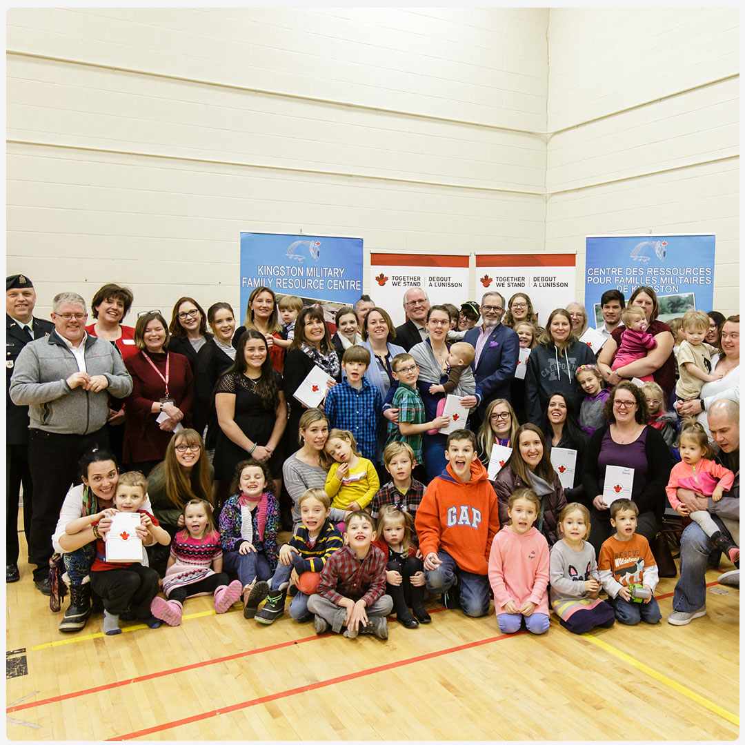 An image of a group of happy families at a Together We Stand event