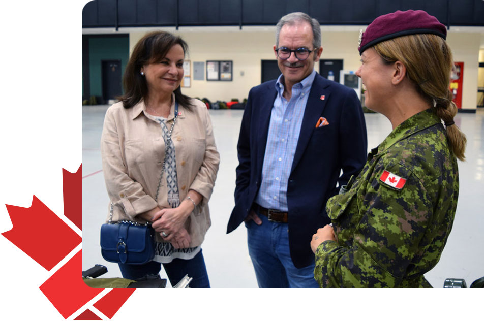 An image of Together We Stand founders meeting with an member of the Canadian Armed Forces