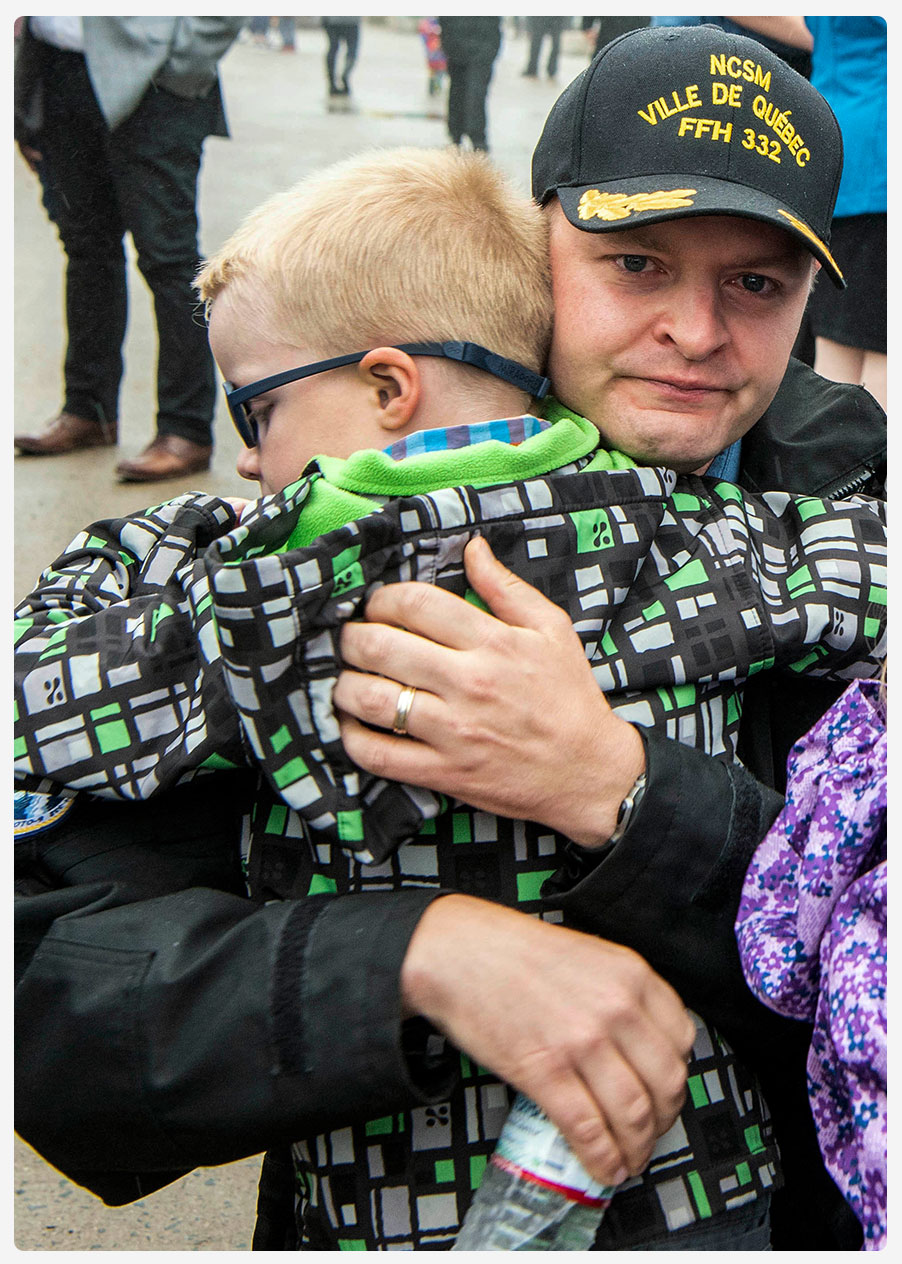 An image of a CAF member reuniting with his son