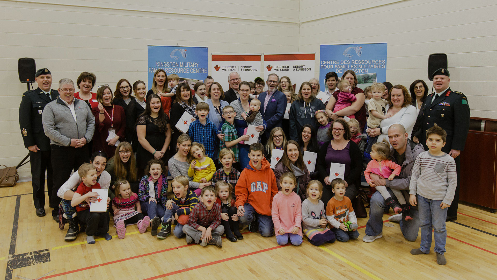 A group of happy families at a Together We Stand event
